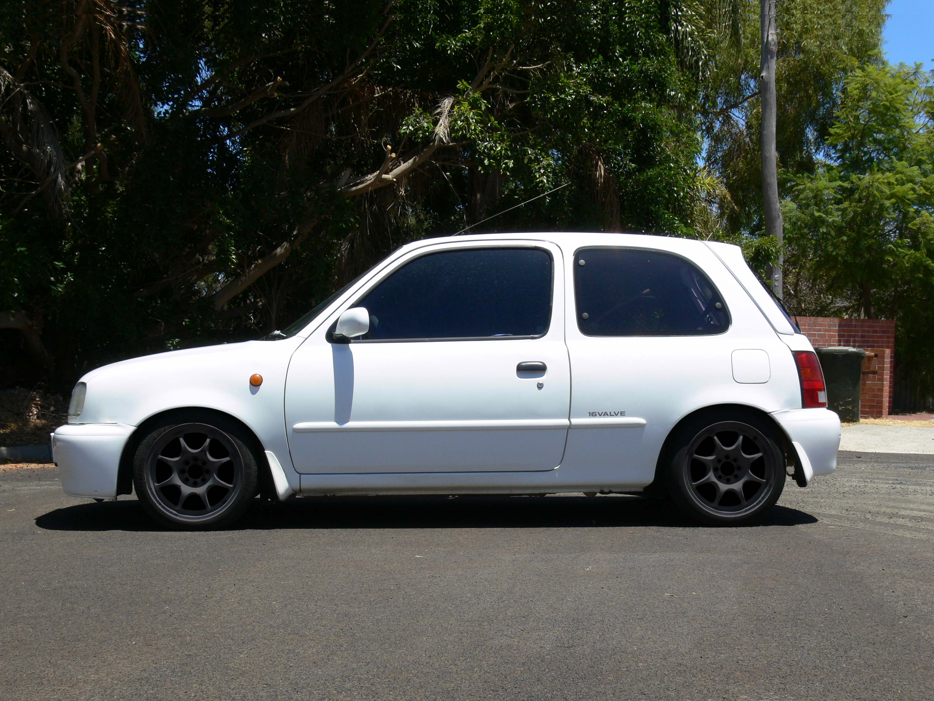 K11 Micra with Black 15x6+30 Weds Sport TC-05 (Photoshopped)
