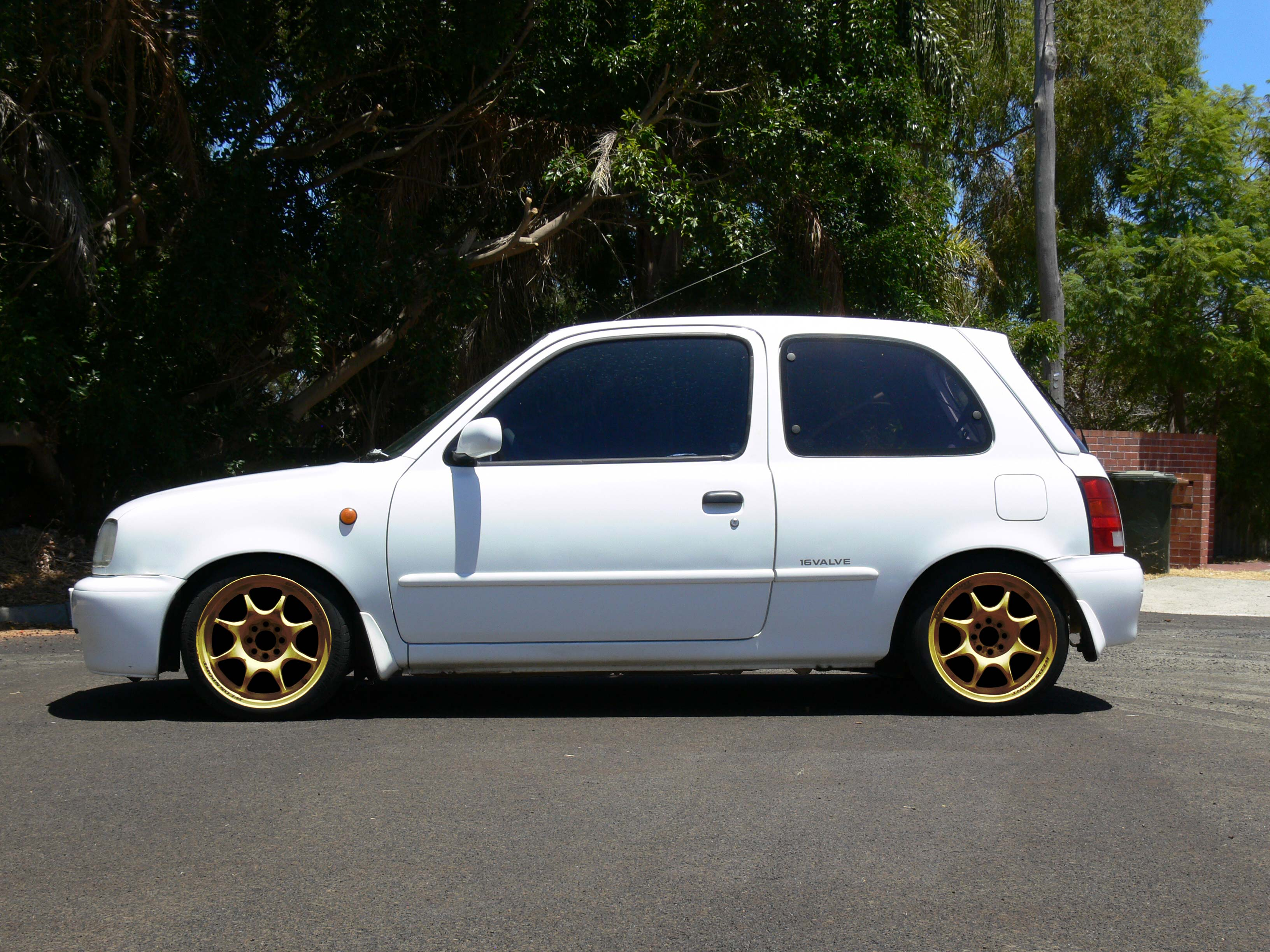 K11 Micra with Gold 15x6+30 Weds Sport TC-05 (Photoshopped)