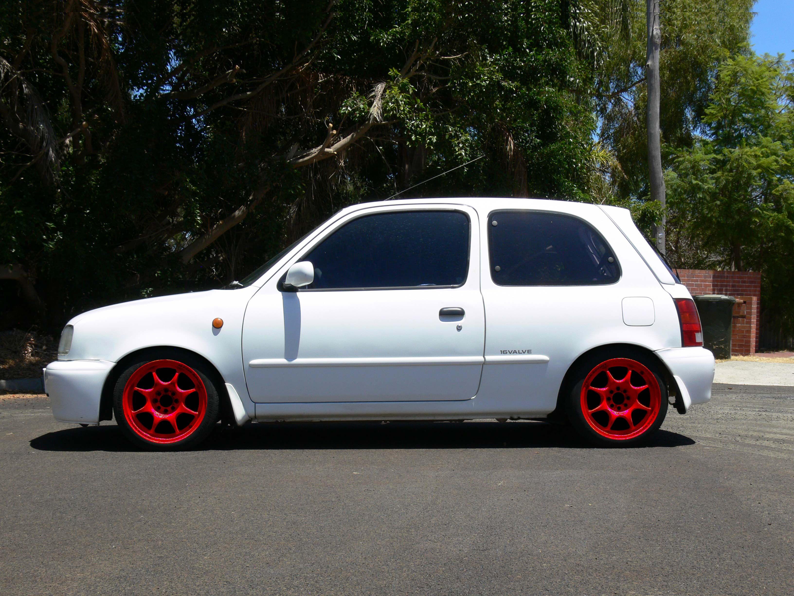 K11 Micra with Red 15x6+30 Weds Sport TC-05 (Photoshopped)