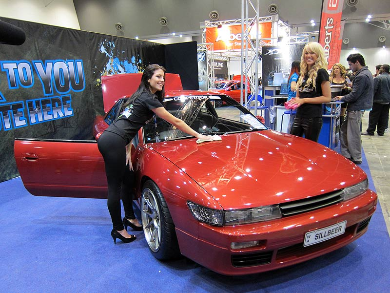 Just Car Insurance promo girls with SILLBEER at Perth Autosalon