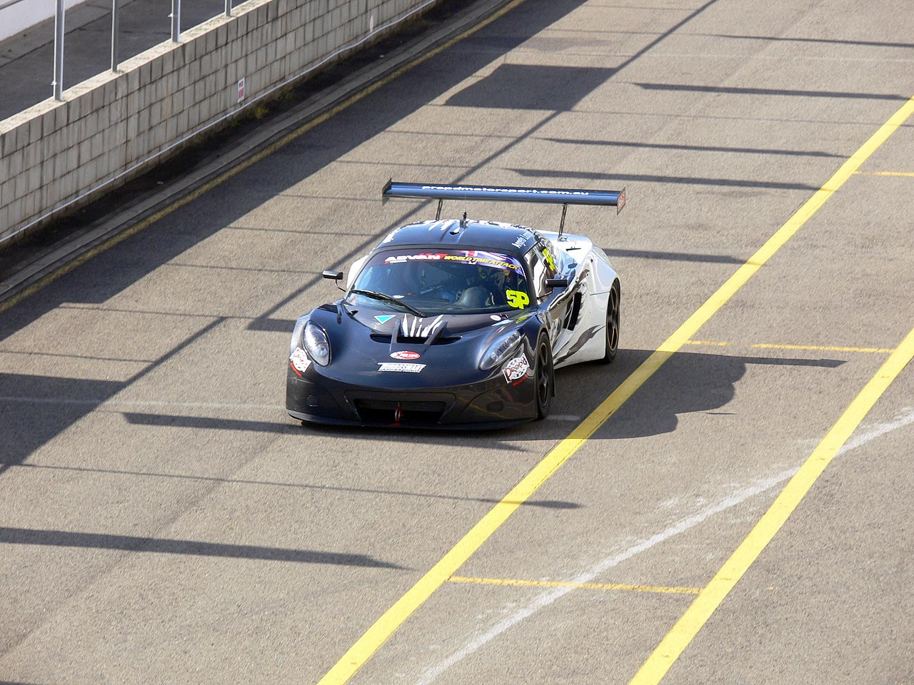 Warren Luff in the Prep'd Motorsport Lotus Exige GT3 coming back into the pits.