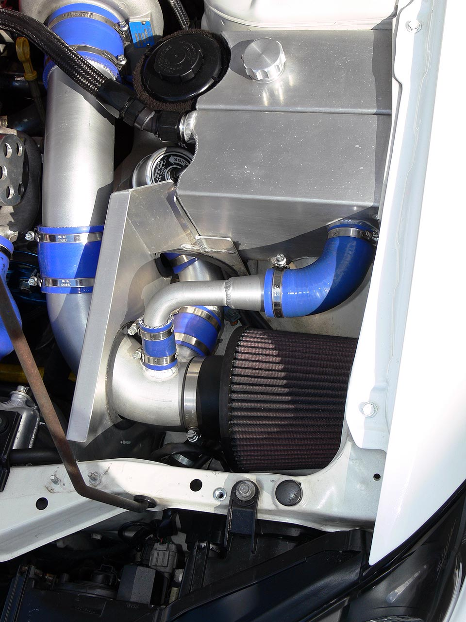 Close up of Nissan S15 Silvia/200SX Engine Bay with Greddy Type-R Blow-off Valve and Cold Air Intake