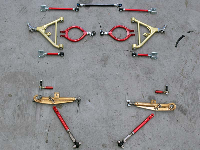 Adjustable suspension arms front and rear